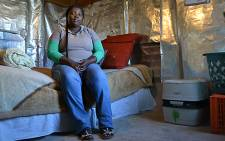 Sisanda Mntakaziwa sits in her home in the Cape Town informal settlement Jan se Bos, which received portable flush toilets from the City of Cape Town, on 6 June 2013. Picture: Aletta Gardner/EWN