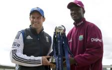 England Test captain Andrew Strauss with West Indies Captain Darren Sammy pose with the test trophy at Lords Cricket Oval. Picture: AFP