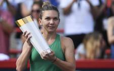 Simona Halep of Romania holds up the trophy during the post-game ceremony after defeating Sloane Stephens 7-6, 3-6, 6-4 in the final on day seven of the Rogers Cup at IGA Stadium on 12 August 2018 in Montreal, Quebec, Canada. Picture: AFP