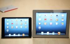 Apple's newly introduced iPad Mini and 4th generation iPad are seen during Apple's special event at the California Theatre in San Jose on October 23, 2012. Picture: AFP.