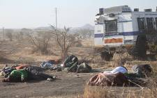 FILE: Miners' bodies lie on the ground after police opened fire at protesting workers at the Lonmin mine in Marikana, 16 August, 2012. Picture: EWN.