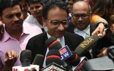 Indian Supreme Court advocate Saif Mahmood (C) meets with the press outside the Supreme Court in New Delhi on 22 August 2017, after India's top court on banned a controversial Islamic practice that allows men to divorce their wives instantly. Picture: AFP.
