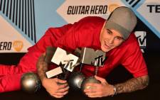 Canadian singer Justin Bieber poses with his trophies in the photo room of the 2015 MTV Europe Music Awards (EMA) at Mediolanum Forum on 25 October, 2015 in Milan. Picture: AFP.