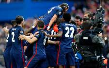 Atletico Madrid players celebrate their hard-earned victory after they dumped Barcelona out of the Uefa Champions League on 13 April 2016. Picture: Atletico Madrid official Facebook page.