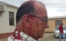 Baviaans Municipality Mayor Ewald Loock was assaulted while trying to address a crowd of protesters this morning. Picture: Siyabonga Sesant/EWN