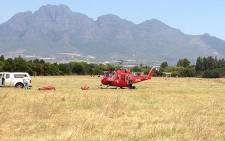 A helicopter prepares to go into action to try and extinguish a runaway fire between Franschhoek and Paarl on 29 January 2013. Picture: Regan Thaw/EWN