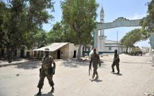 A photo provided by the AU peace enforcement mission AMISON of soldiers of the Somali National Army as they patrol the port city of Marka, Lower Shabelle Region on 12 February, 2016. Picture: EPA/ILYAS AHMED.