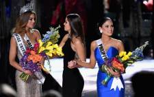 FILE: (L-R) Miss Colombia 2015, Ariadna Gutierrez, and Miss Universe 2014, Paulina Vega, react as Miss Phillipines 2015, Pia Alonzo Wurtzbach is named 2015 Miss Universe. Picture: AFP