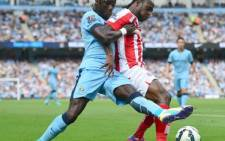 FILE: Former Stoke Citys forward Victor Moses vies with Manchester City's defender Bacary Sagna during the English Premier League football match between Manchester City and Stoke City, 30 August, 2014. Picture: AFP.