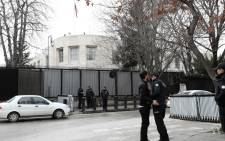 Policemen search a man outside the United States embassy in Ankara, on 5 March 2018. Picture: AFP