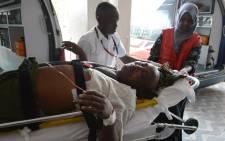 A victim of the attack on a Kenyan university, arrives at the Kenyatta hospital, on 2 April, 2015 in Nairobi. Al-Shebab gunmen seized Christian hostages at a Kenya university near the border with Somalia. Picture: AFP.
