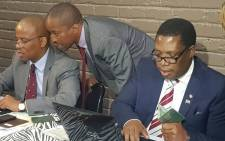 FILE: Gauteng MEC for Education Panyaza Lesufi assisting a parent during 2019 online registration. Picture: @EducationGP/Twitter