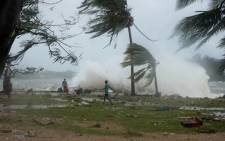 """FILE: The huge tropical cyclone smashed into Vanuatu in the South Pacific, terrifying residents and leaving """"complete devastation"""" with fears on March 14 that dozens of people may have died. Picture: AFP"""