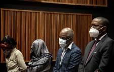 Sybil Ngcobo, Mmakgosi Mosupi, Valdis Romaano and Obakeng Mookeletsi appear at the Palm Ridge Magistrates Court on 22 October 2020 on corruption charges. Picture: Xanderleigh Dookey/EWN
