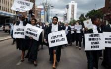 "Lawyers of the Law Society of Zimbabwe bar association take part in a ""March for Justice"" toward the Constitutional Court in Harare on 29 January 2019, to call for restoration of the rule of law, respect of human rights as well as the country's Constitution. Picture: AFP."