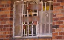 Pollsmoor Prison inmates looking out of a window at the facility. Picture: EWN