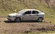 A video grab made on 2 April, 2016, shows an image taken from a footage made available on the Nagorno Karabakh Republic Defence Ministrys official website on 2 April, 2016, reportedly showing a damaged car in Armenian-seized Azerbaijani region of Nagorny Karabakh after clashes between Armenian and Azeri forces. Picture: AFP.