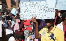 A young woman holds a placard during a march for free basic education on August 17, 2016, in Bulawayo, Zimbabwe. Picture: AFP