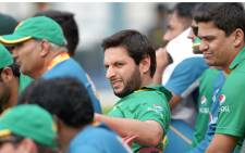 Pakistan's captain Shahid Afridi reacts as he watches a practice match between Pakistan and Sri Lanka at the Eden Gardens stadium during the World T20 cricket tournament in Kolkata on 14 March 2016. Picture: AFP/Dibyangshu SARKAR