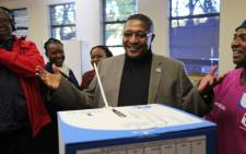 IEC chairperson Glen Mashinini casts his special vote. Picture: Christa Eybers/EWN.