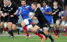 All Blacks player Aaron Cruden makes a break during the international rugby test match between the New Zealand All Blacks and France in Auckland on 8 June 2013. Picture: AFP