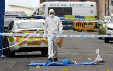 A police forensics officer gathers evidence near to evidence markers inside a cordon on Irving Street, following a major stabbing incident in the centre of Birmingham, central England, on 6 September 2020. Picture: AFP