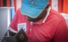An IEC official takes down the details of a new eligible voter registering in the Denver community near Johannesburg's CBD. Picture: Reinart Toerien/EWN.