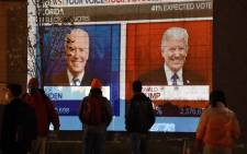 People watch a big screen displaying the live election results in Florida at Black Lives Matter plaza across from the White House on election day in Washington, DC on 3 November 2020. Picture: AFP