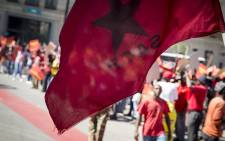 An SACP flag flies outside national treasury in Pretoria on 21 April 2017 during a protest against what it calls the capture of South Africa's finance sector. Picture: EWN