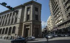 Cars drive past the Egyptian Central Bank in downtown Cairo on 3 November 2016. Picture: AFP.