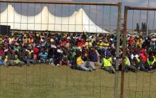 Cosatu and ANC supporters waiting to be addressed by ANC Deputy President Cyril Ramaphosa at the Seshego Stadium. Picture: Pelane Phakgadi/EWN.