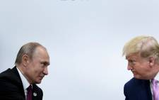 FILE: US President Donald Trump (R) attends a meeting with Russia's President Vladimir Putin during the G20 summit in Osaka on 28 June 2019. Picture: AFP