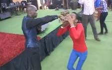 Pastor Lesego Daniel apparently told a congregation to drink petrol saying it had a sweet taste to it. Picture: YouTube.