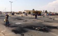 Rubble lies strewn across several streets of Daveyton following protests over housing. Picture: Reinart Toerien/EWN.