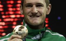 Gold medalist Cameron Van Der Burgh poses on the podium with his medal during the award ceremony of the men's 50-metre breaststroke swimming event in the FINA World Championships at Palau Sant Jordi in Barcelona on July 31, 2013. Picture: AFP.