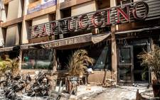 A general view of damaged outside of the Cappuccino bar opposite the Splendid Hotel in Ouagadougou, Burkina Faso on 18 January 2016. Picture: EPA