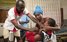 FILE: In this photograph taken on 27 February 2019, a Malagasy child is inoculated with Measles Vaccine during a measles epidemic, at a Basic Health Centre Level 2 (CSB 2) in the village of Anivorano, North Antsiranana on the outskirts of Antsiranana. Picture: AFP