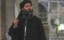 FILE: A frame from video released by the Islamic State (IS) purportedly shows the caliph of the self-proclaimed Islamic State, Abu Bakr al-Baghdadi, giving a speech in an unknown location.