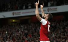 Arsenal's French striker Olivier Giroud celebrates scoring Arsenal's fourth goal during the English Premier League football match between Arsenal and Leicester City at the Emirates Stadium in London on 11 August  2017. Picture: AFP.