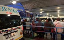 Commuters wait for taxis on the station deck in Cape Town Picture: Kaylynn Palm/EWN