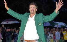 2013 Masters champion Adam Scott celebrates in the famous green jacket. Picture: Facebook.com.