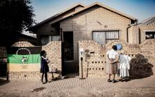 Dube residents outside Andrew Mlangeni's home in Soweto on 22 July 2020 after the struggle stalwart passed away. Picture: Sethembiso Zulu/EWN.