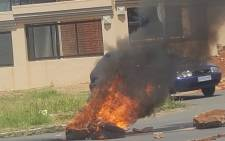A picture of a burning tyre from the Lenasia protest that took place on 19 February 2019. Picture: Faizel Patel/EWN.
