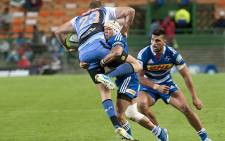 The Stormers's Cheslin Kolbe (C) tackles the Western Force's Patrick Dellit (L) during the Super Rugby 15 match between Western Force and the Stormers at the Newlands Stadium on 17 May 2014, in Cape Town. Picture: AFP/ RODGER BOSCH