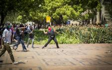 FILE: #FeesMustFall supporters hurl rocks at campus security standing at the Great Hall on Wits University's main campus on 11 October 2016. Picture: Reinart Toerien/EWN.