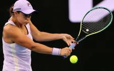 Australia's Ashleigh Barty hits a return against Russia's Ekaterina Alexandrova during their women's singles match on day six of the Australian Open tennis tournament in Melbourne on 13 February 2021. Picture: Brandon MALONE / AFP
