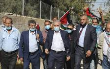 Palestinian Prime Minister Muhammad Shtayyeh (C), clad in mask due to the COVID-19 coronavirus pandemic, leaves following a meeting with members of his government and officials of the Palestine Liberation Organisation (PLO) in the Jordan Valley village of Fasayil in the occupied West Bank on 24 June 2020, to discuss Israel's West Bank annexation plans. Picture: AFP