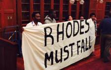 FILE: University of Cape Town students leadership hold a banner in support of Rhodes University students in their bit to have Cecil Rhodes statute on 26 March 2015. Picture: Masa Kekana/EWN.