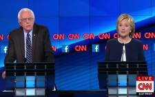 Democratic presidential candidate US Senator Bernie Sanders listens as former Secretary of State Hillary Clinton speaks during the first official Democratic candidates debate of the 2016 presidential campaign in Las Vegas, Nevada on 13 October, 2015. Picture: Screengrab/CNN.