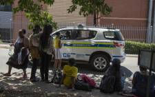 Police monitor the situation at Unisa Sunnyside following chaos that erupted over registration on Monday 15 January. Picture: Ihsaan Haffejee/EWN.
